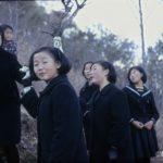 Schoolgirls  walking in the beautiful park in Chonju