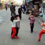 Children playing a hopscotch game on a Chonju street