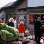 Locals watch as a gentleman makes his purchase in a busy Chonju marketplace       2/2