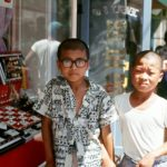Two boys in front of a Jewelry store.  I still wear a pin  I bought at this store