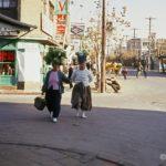 Two women returning from the market along Kunsans main street.