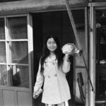 A hip young women leaves a Kunsan shop with her purchase