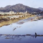 Kimchi pots line the riverbank in the busy city of Chonju.