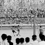 Students watching an exciting soccer game at a Chonju school