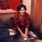 U Myung-cha washing her classic Korean rubber shoes