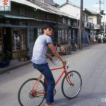 """A """"slicky boy"""" with his bicycle near the Kunsan waterfront"""